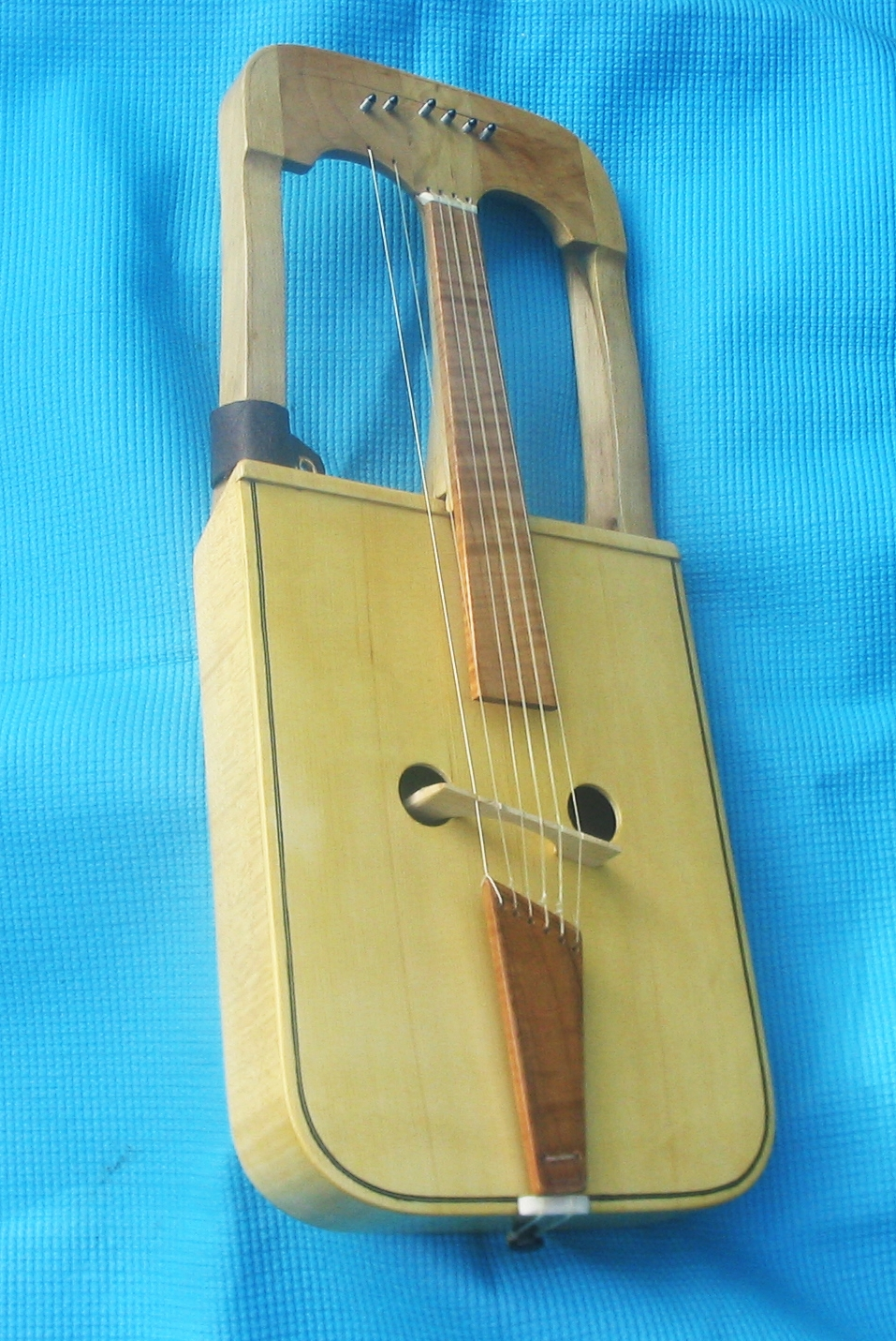 crwth with natural finish